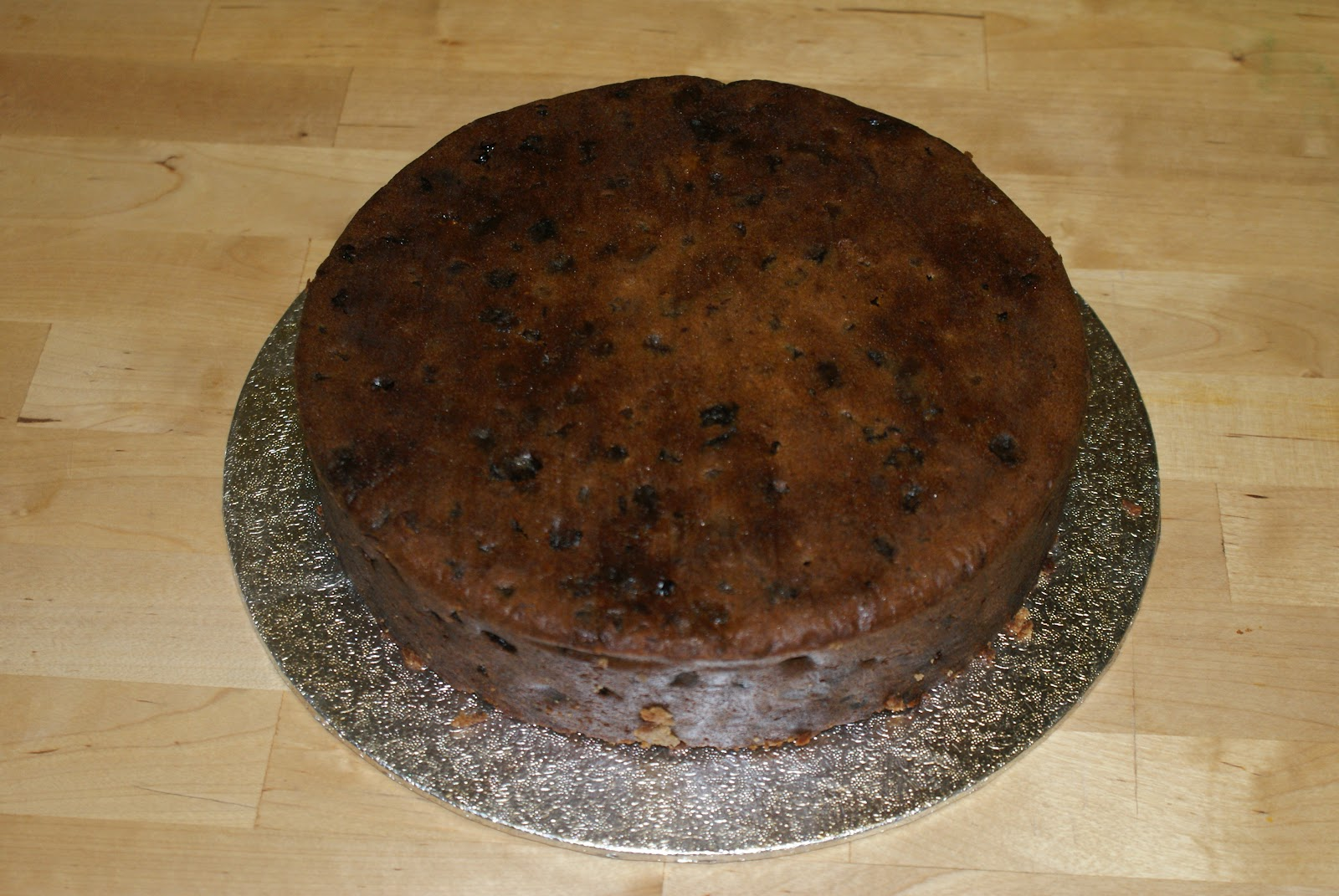 How to marzipan a christmas cake - Check That You Re Happy With Your Levelling And Adjust If Necessary A Small Sausage Of Marzipan Just Under The Cake Can Help To Level If You Don T Want To
