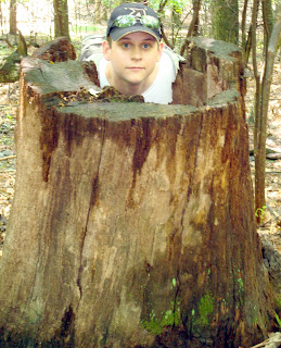 Joshua DeLung in a stump on a Blue Ridge Parkway trail