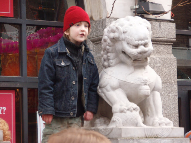London+Chinese+New+Year+celebrations+boy+with+stone+lion