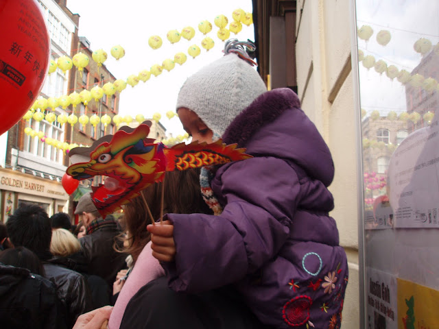 London+Chinese+New+Year+celebrations+Girl+with+Dragon+toy