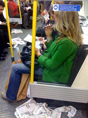 London Underground train, floor covered with discarded London News and Lite,