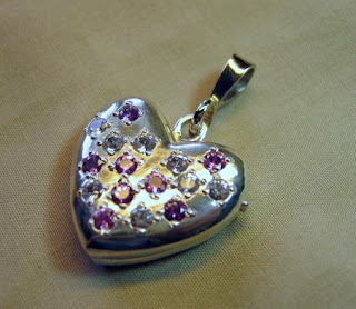 Sterling silver locket with pink and white natural sapphires by jewelry designer Tony Payne