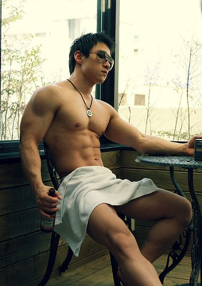 sexy muscular Asian guy wearing only a towel. Sorta.