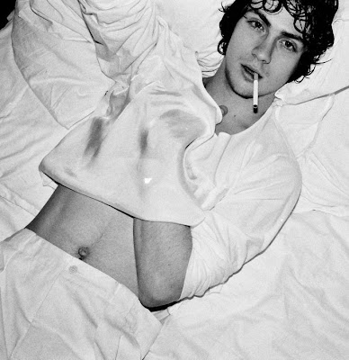 sexy Aaron Johnson in all white, smoking in bed
