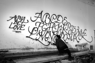 Black Font Graffiti Alphabet Tagging on the Wall