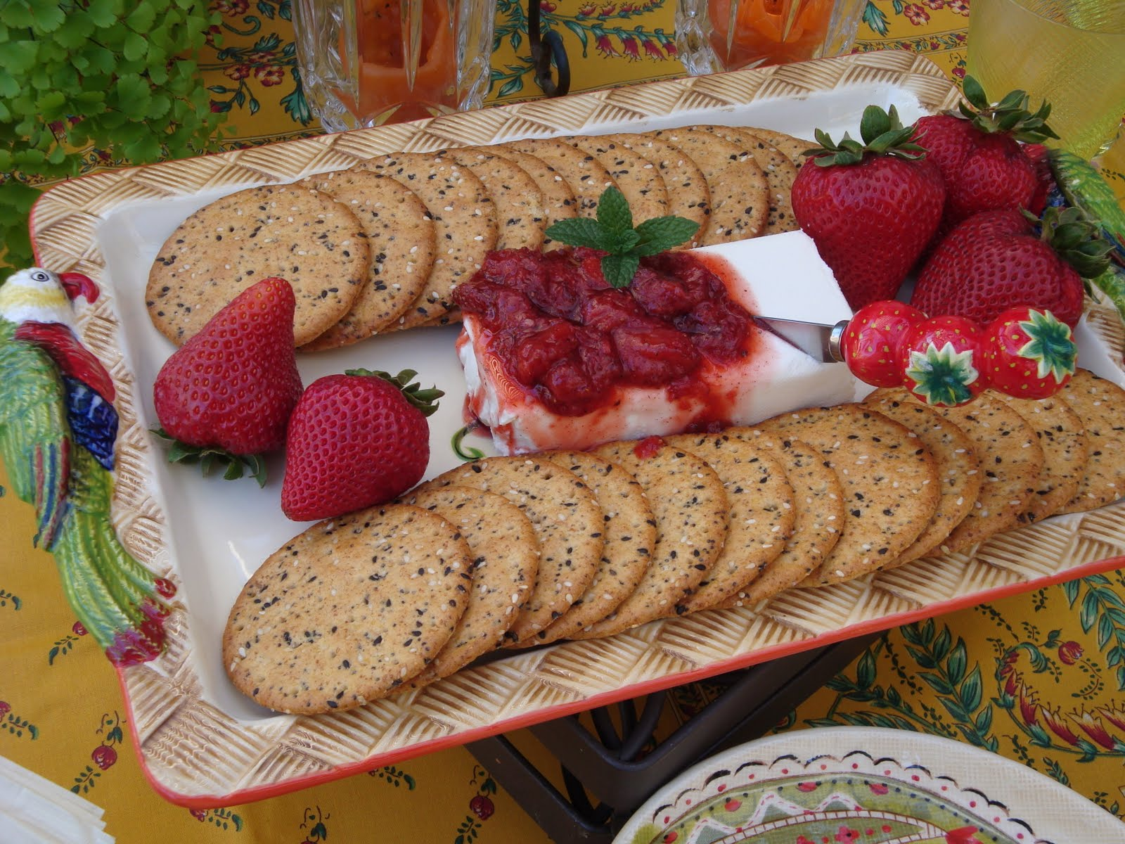 Strawberry chutney served over a block of cream cheese with crackers ...