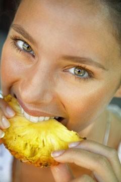 woman eating pineapple gif