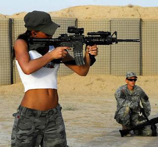 Sexy Rachelle Leah with a Gun