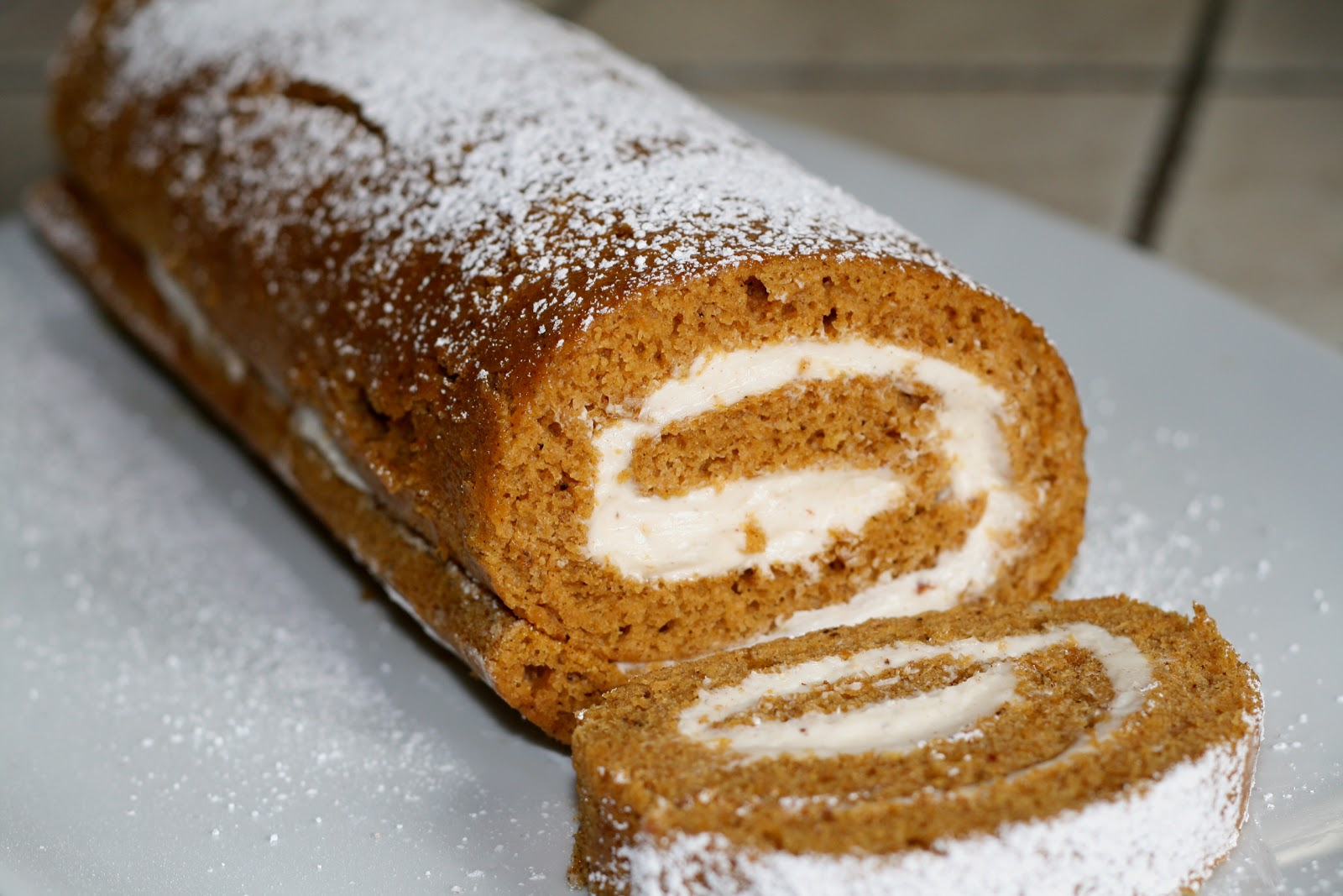 pumpkin roll moist pumpkin cake is rolled up with a spiced cream ...
