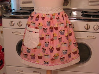 she creates these adorable vintage inspired aprons i immediately knew that this cupcake print was perfect for the baking basket but the pink was not right
