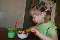 clara eating with spoon