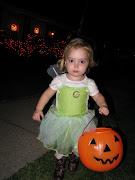 . on wearing her boots with her Tinkerbell costume for trickortreating!