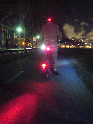 three tail lights on a Brompton