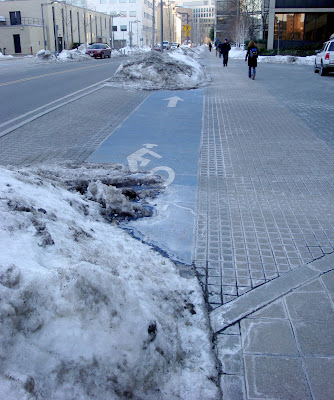 snow dumped in Cambridge bike lanes
