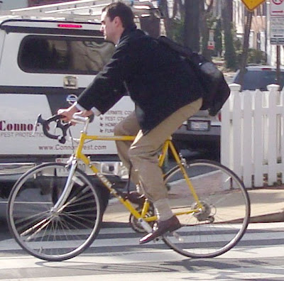 khakis navy blue blazer yellow bike