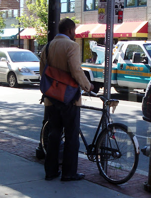 3 speed cyclist with a messenger bag