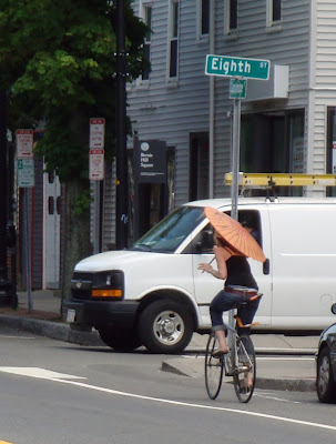 bicycling with a parasol