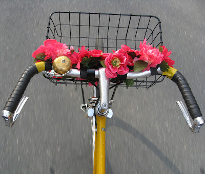 rolling with flowers on her bike