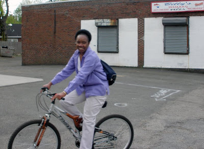 lady cyclist Dorchester white trousers