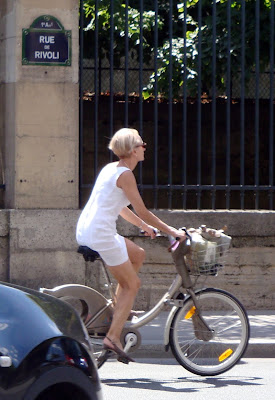 elegant cyclist on a Velib