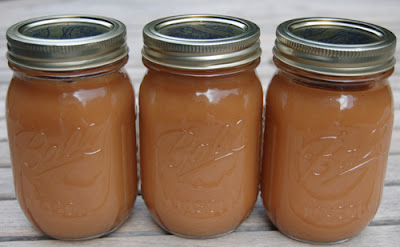 Three pint jars of my homemade applesauce from this fall