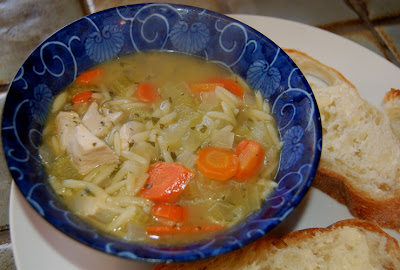 Chicken vegetable soup with orzo, served with buttered rustic baguette