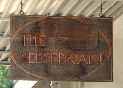Close up of Cheeseboard's sign