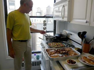 Photo of Mark Bittman cooking in his NYC kitchen by Kelly Doe