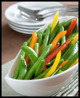 pine nut butter drizzled green beans with sweet peppers