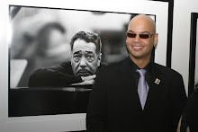 Paul Ellington in front of a portrait of his Grandfather at The Morrison Hotel Gallery in New York