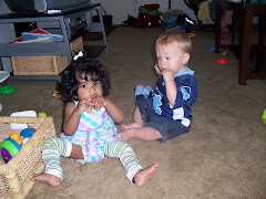Pryanka and Korbin eating carrots