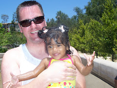 Pryanka & Daddy getting soaked at the park