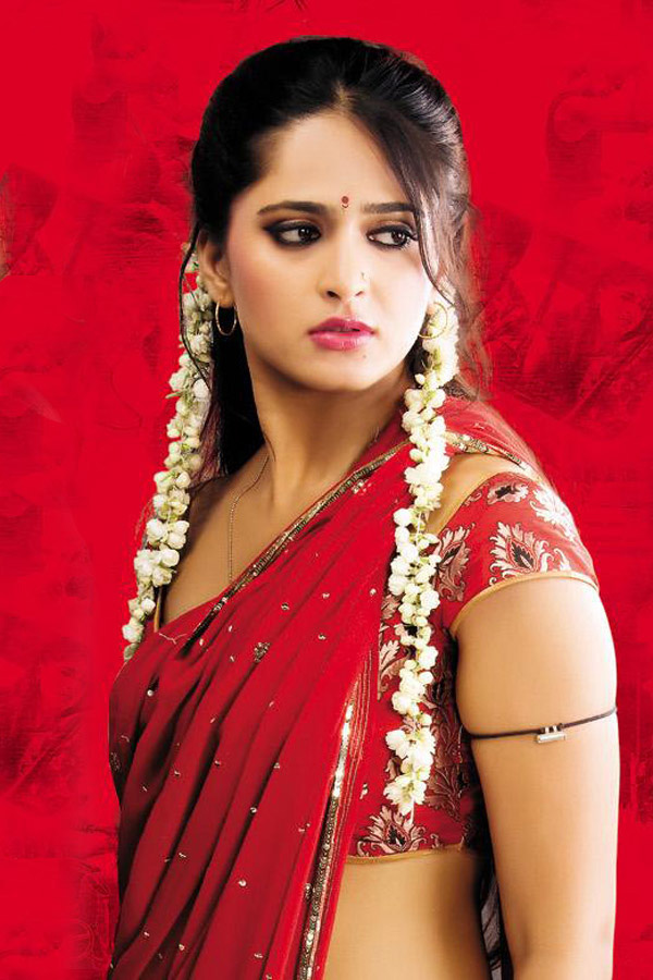 Actress Anushka Shetty in Red Saree - Stills From Telugu Movie Vedam