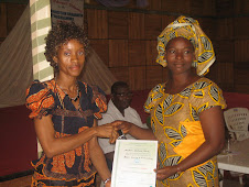 One of the graduates receiving her certificate from Mercy, Assistant Coordinator at ICL...
