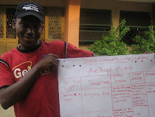 Tim, Youth Volunteer Coordinator, with the programme action plan...