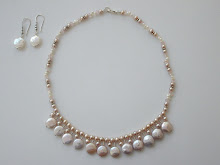 Hanging fresh water coin pearls with small pearls $120