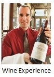 Photo of a waiter with a bottle of wine.