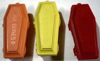 Orange, yellow and red Mr Bones coffins