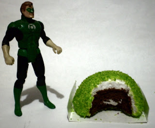 Green Lantern action figure with half eaten Hostess Glo Ball