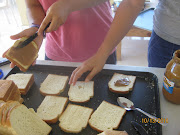 Peanut butter sandwiches, being made on sliced bread baked at the bakery.