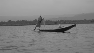 An Intha one-leg-rower fisherman, Inle lake, Shan state