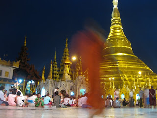 A monk walking past Shwedagon Pagoda