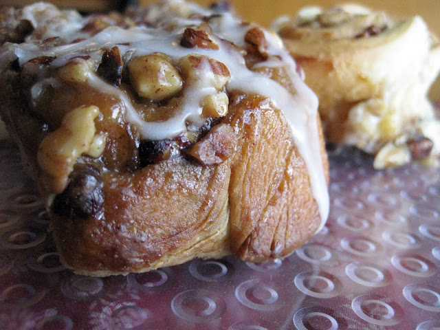 gooey cinnamon buns with hazelnuts and icing