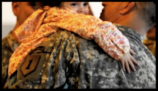 Picture of Army soldier holding infant