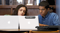 two students using Mac books