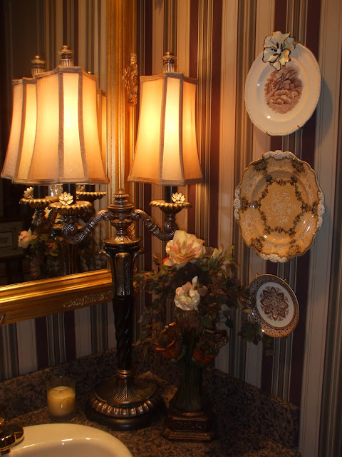 a grouping of plates and platters frame a baroque portrait in the powder bath spode bottom and bottom right