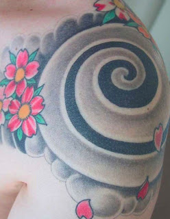 Flower and Tribal Tattoo Design in Side
