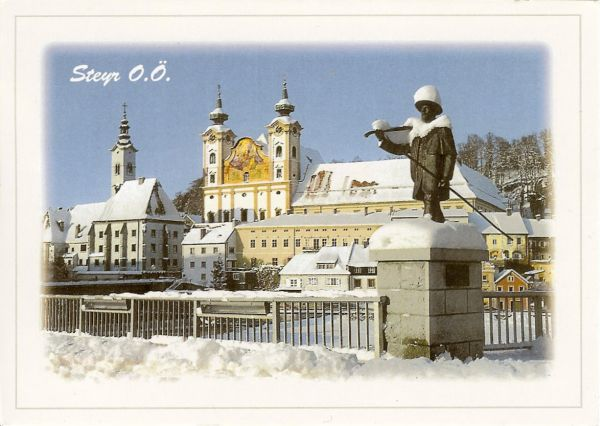 snow scene showing bridge, monument and two churches