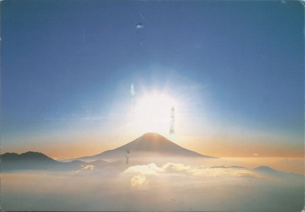mount fuji at dawn through clouds