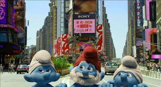 Three Smurfs, with Papa Smurf in the middle, peeking out of a manhole in New York's Time Square and enjoying the sights.